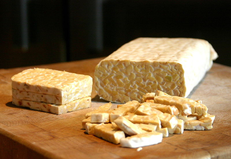 """Sliced tempeh"" by FotoosVanRobin from Netherlands - Tempe. Licensed under CC BY-SA 2.0 via Commons - https://commons.wikimedia.org/wiki/File:Sliced_tempeh.jpg#/media/File:Sliced_tempeh.jpg"